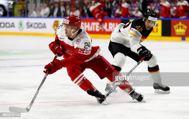 Nikolaj Ehlers of Denmark challenges Yasin Ehliz of Germany for the puck during the 2017 IIHF Ice Hockey World Championship game between Denmark and...