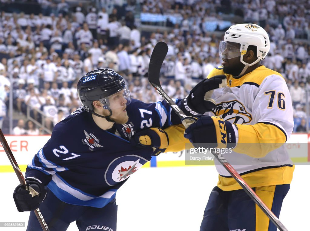 Nikolaj Ehlers #27 of the Winnipeg Jets and P.K. Subban #76 of the Nashville Predators mix it up during third period action in Game Six of the Western Conference Second Round during the 2018 NHL Stanley Cup Playoffs at the Bell MTS Place on May 7, 2018 in Winnipeg, Manitoba, Canada.