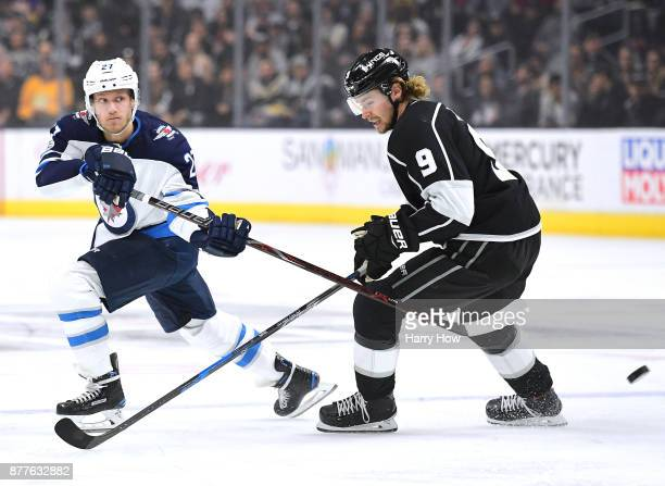Nikolaj Ehlers of the Winnipeg Jets attempts a backhand past Adrian Kempe of the Los Angeles Kings at Staples Center on November 22 2017 in Los...