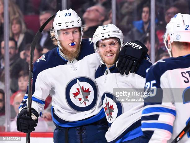 Nikolaj Ehlers of the Winnipeg Jets celebrates a firstperiod goal with teammate Patrik Laine against the Montreal Canadiens during the NHL game at...