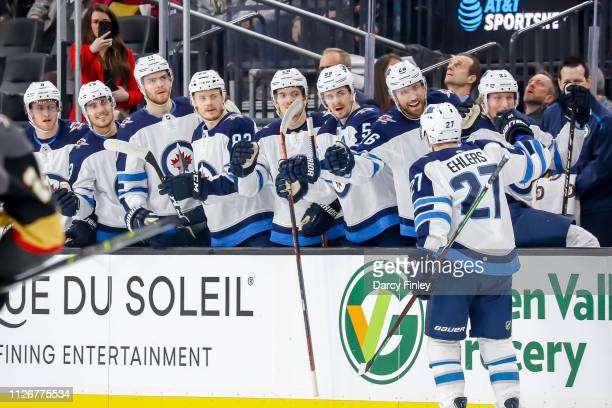 Nikolaj Ehlers of the Winnipeg Jets celebrates his first period goal against the Vegas Golden Knights with teammates at the bench at TMobile Arena on...
