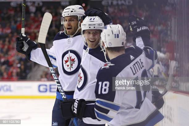 Nikolaj Ehlers of the Winnipeg Jets celebrates his goal with teammates against the Washington Capitals during the first period at Capital One Arena...