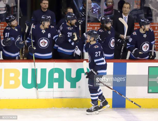 Nikolaj Ehlers of the Winnipeg Jets celebrates his second period goal against the Florida Panthers with teammates at the bench at the Bell MTS Place...