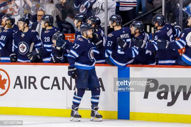Nikolaj Ehlers of the Winnipeg Jets celebrates his third period goal against the Tampa Bay Lightning with teammates at the bench at the Bell MTS...