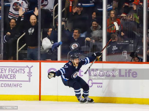 Nikolaj Ehlers of the Winnipeg Jets celebrates his third period hattrick goal against the Chicago Blackhawks at the Bell MTS Place on November 29...