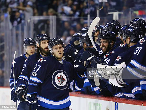 Nikolaj Ehlers of the Winnipeg Jets celebrates his third period goal against the Arizona Coyotes with teammates at the bench at the MTS Centre on...