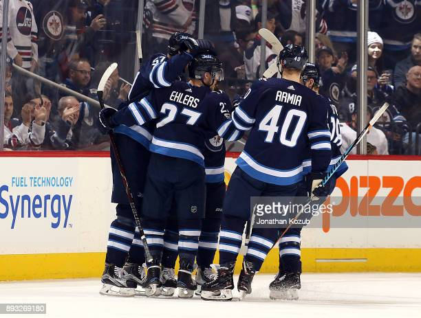 Nikolaj Ehlers of the Winnipeg Jets celebrates his third period goal against the Chicago Blackhawks with teammates on the ice at the Bell MTS Place...