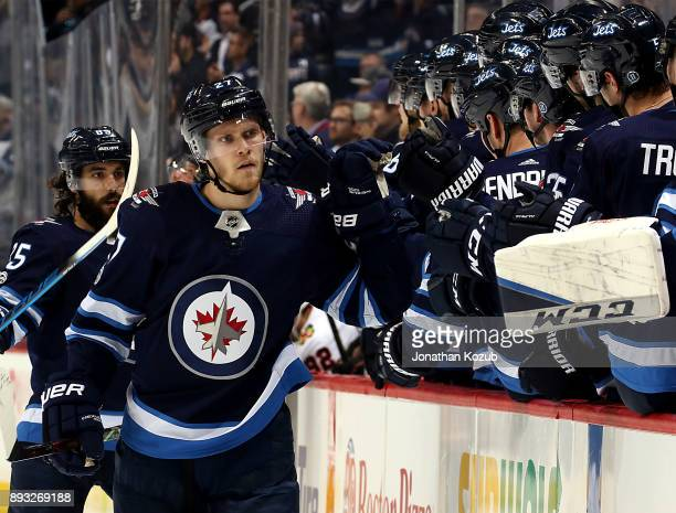 Nikolaj Ehlers of the Winnipeg Jets celebrates his third period goal against the Chicago Blackhawks with teammates at the bench at the Bell MTS Place...