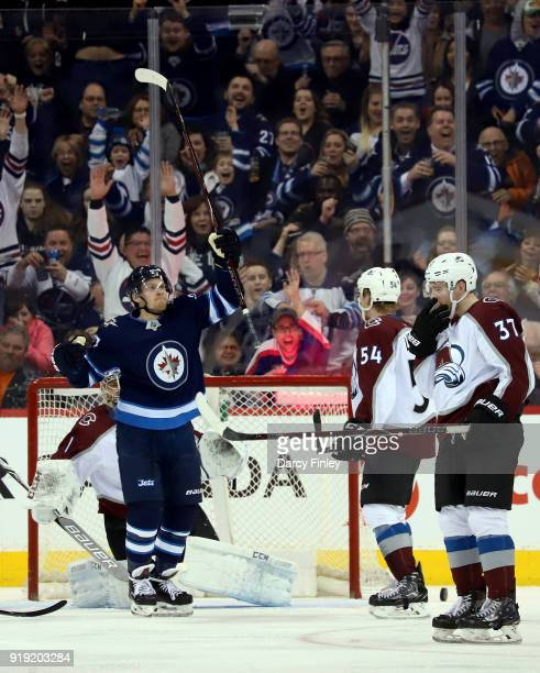 Nikolaj Ehlers of the Winnipeg Jets celebrates his third period goal as Anton Lindholm and JT Compher of the Colorado Avalanche look on at the Bell...