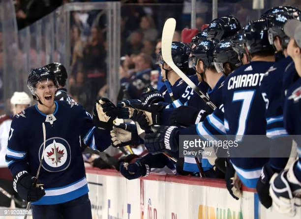 Nikolaj Ehlers of the Winnipeg Jets celebrates his third period goal against the Colorado Avalanche with teammates at the bench at the Bell MTS Place...