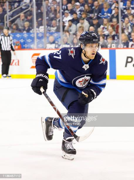 Nikolaj Ehlers of the Winnipeg Jets follows the play down the ice during third period action against the San Jose Sharks at the Bell MTS Place on...