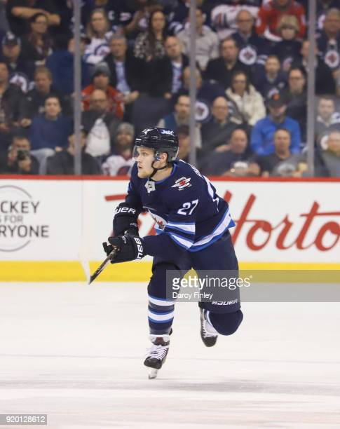 Nikolaj Ehlers of the Winnipeg Jets follows the play down the ice during second period action against the Washington Capitals at the Bell MTS Place...