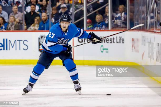 Nikolaj Ehlers of the Winnipeg Jets gets set to shoot the puck down the ice during second period action against the Calgary Flames at the Bell MTS...