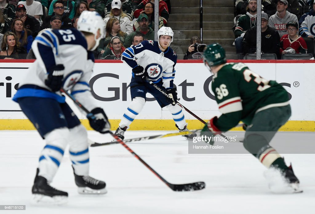 Nikolaj Ehlers #27 of the Winnipeg Jets has the puck as Nick Seeler #36 of the Minnesota Wild defends Paul Stastny #25 of the Winnipeg Jets during the first period in Game Three of the Western Conference First Round during the 2018 NHL Stanley Cup Playoffs at Xcel Energy Center on April 15, 2018 in St Paul, Minnesota. The Wild defeated the Jets 6-2.