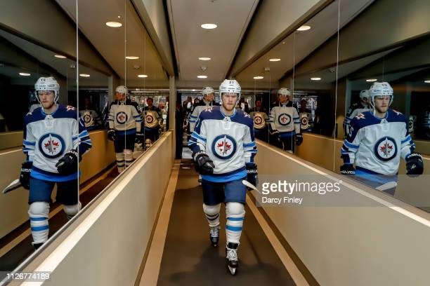 Nikolaj Ehlers of the Winnipeg Jets heads off the ice following the pregame warm up prior to NHL action against the Vegas Golden Knights at TMobile...