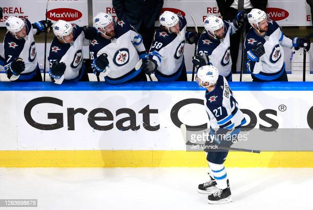 Nikolaj Ehlers of the Winnipeg Jets is congratulated by teammates on the bench after he scored a goal in the third period against the Calgary Flames...