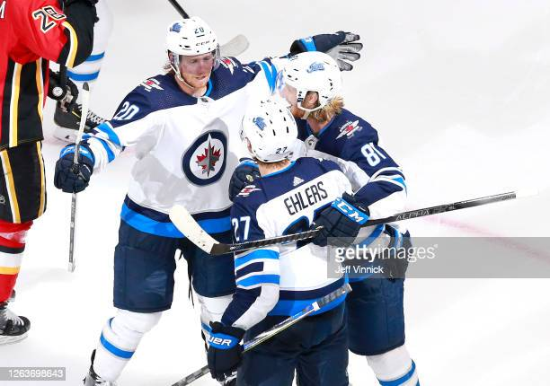 Nikolaj Ehlers of the Winnipeg Jets is congratulated by teammates Cody Eakin and Kyle Connor after Ehlers scored in the third period against the...