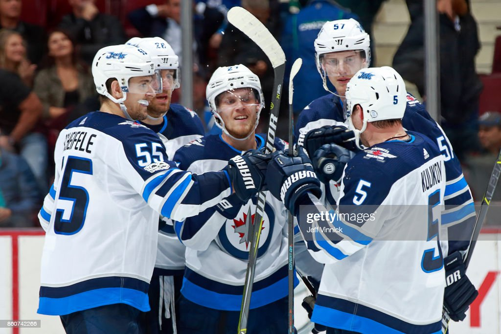 Nikolaj Ehlers #27 of the Winnipeg Jets is congratulated by teammates after scoring during their NHL game at Rogers Arena October 12, 2017 in Vancouver, British Columbia, Canada. The final score was 4-2 for the Winnipeg Jets.
