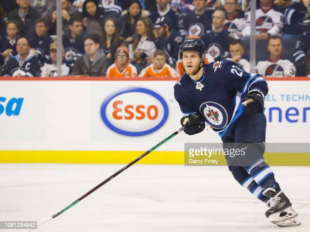 Nikolaj Ehlers of the Winnipeg Jets keeps an eye on the play during first period action against the Philadelphia Flyers at the Bell MTS Place on...