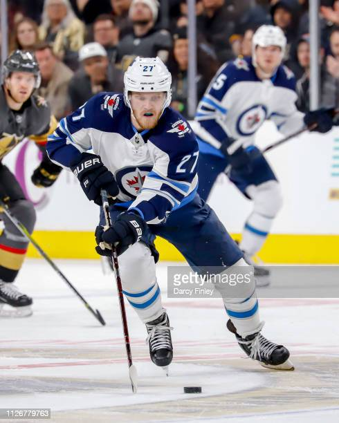 Nikolaj Ehlers of the Winnipeg Jets plays the puck down the ice during third period action against the Vegas Golden Knights at TMobile Arena on...