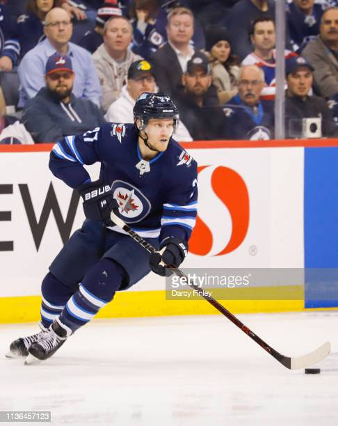 Nikolaj Ehlers of the Winnipeg Jets plays the puck down the ice during second period action against the San Jose Sharks at the Bell MTS Place on...