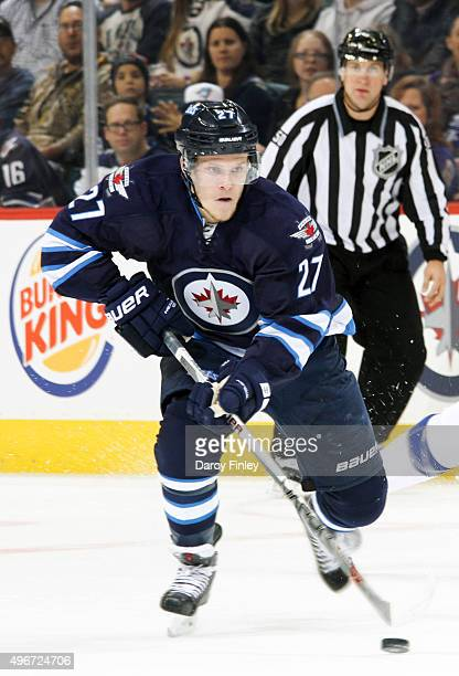 Nikolaj Ehlers of the Winnipeg Jets plays the puck down the ice during first period action against the Tampa Bay Lightning at the MTS Centre on...