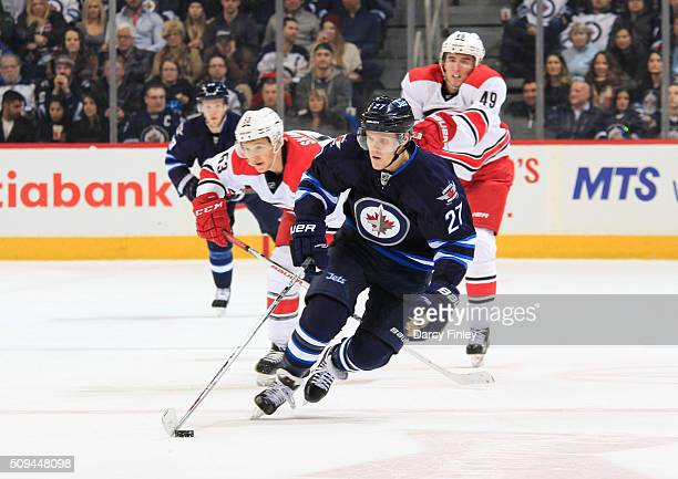 Nikolaj Ehlers of the Winnipeg Jets plays the puck down the ice during second period action against the Carolina Hurricanes at the MTS Centre on...