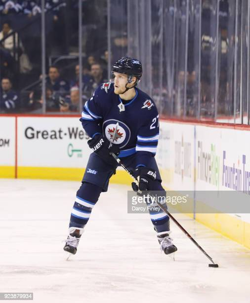 Nikolaj Ehlers of the Winnipeg Jets plays the puck down the ice during third period action against the Los Angeles Kings at the Bell MTS Place on...