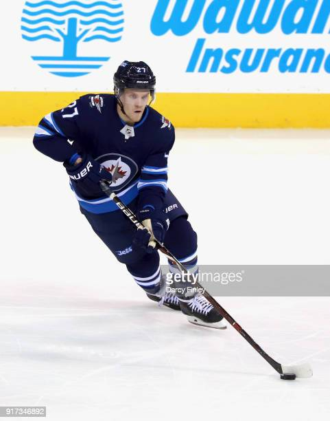 Nikolaj Ehlers of the Winnipeg Jets plays the puck up the ice during second period action against the St Louis Blues at the Bell MTS Place on...