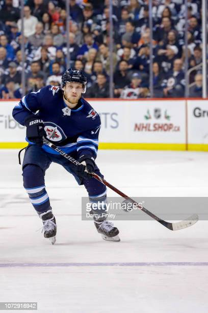 Nikolaj Ehlers of the Winnipeg Jets shoots the puck down the ice during second period action against the Edmonton Oilers at the Bell MTS Place on...