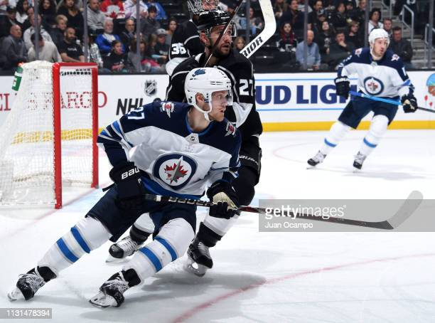 Nikolaj Ehlers of the Winnipeg Jets skates against Alec Martinez of the Los Angeles Kings during the second period of the game at STAPLES Center on...