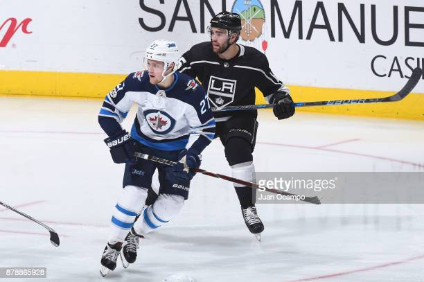 Nikolaj Ehlers of the Winnipeg Jets skates against Andy Andreoff of the Los Angeles Kings at STAPLES Center on November 22 2017 in Los Angeles...