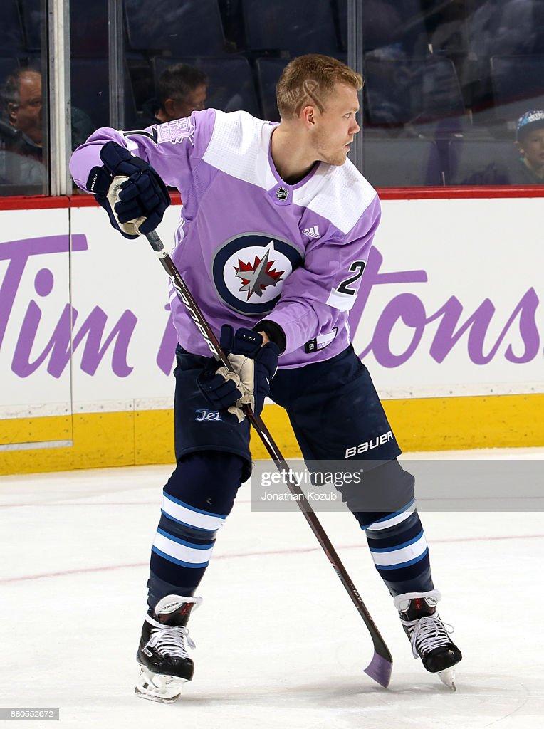 best sneakers 5f9e2 b43a1 Nikolaj Ehlers of the Winnipeg Jets sports a lavender jersey ...