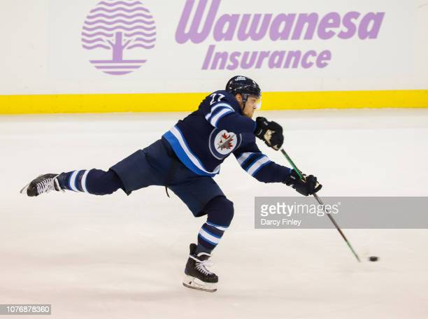 Nikolaj Ehlers of the Winnipeg Jets takes a shot on goal during second period action against the Chicago Blackhawks at the Bell MTS Place on November...