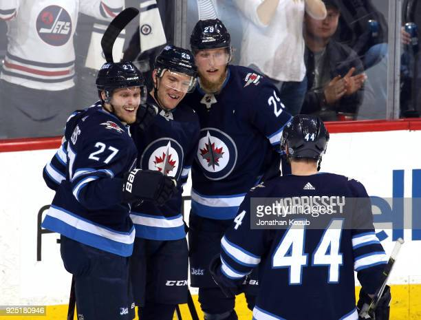Nikolaj Ehlers Paul Stastny Patrik Laine and Josh Morrissey of the Winnipeg Jets celebrate a third period goal against the Nashville Predators at the...