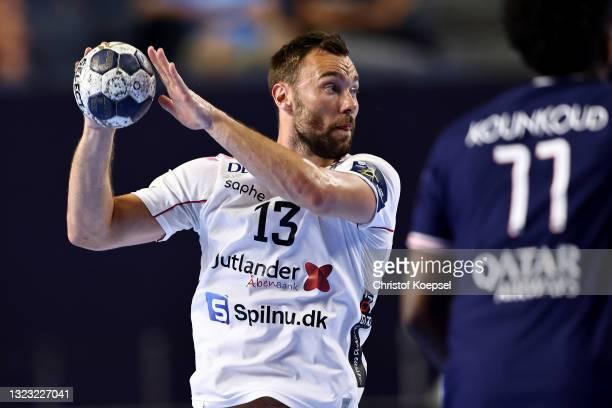 Nikolaj Laesoe Christensen of Aalborg Handbold passes the ball during the VELUX EHF Champions League FINAL4 semi-final between Aalborg Handbold v...