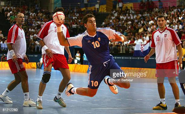 Nikolaos Kokolodimitrakis of Greece shoots during the men's handball quarterfinal match between Greece and Croatia on August 24 2004 during the...