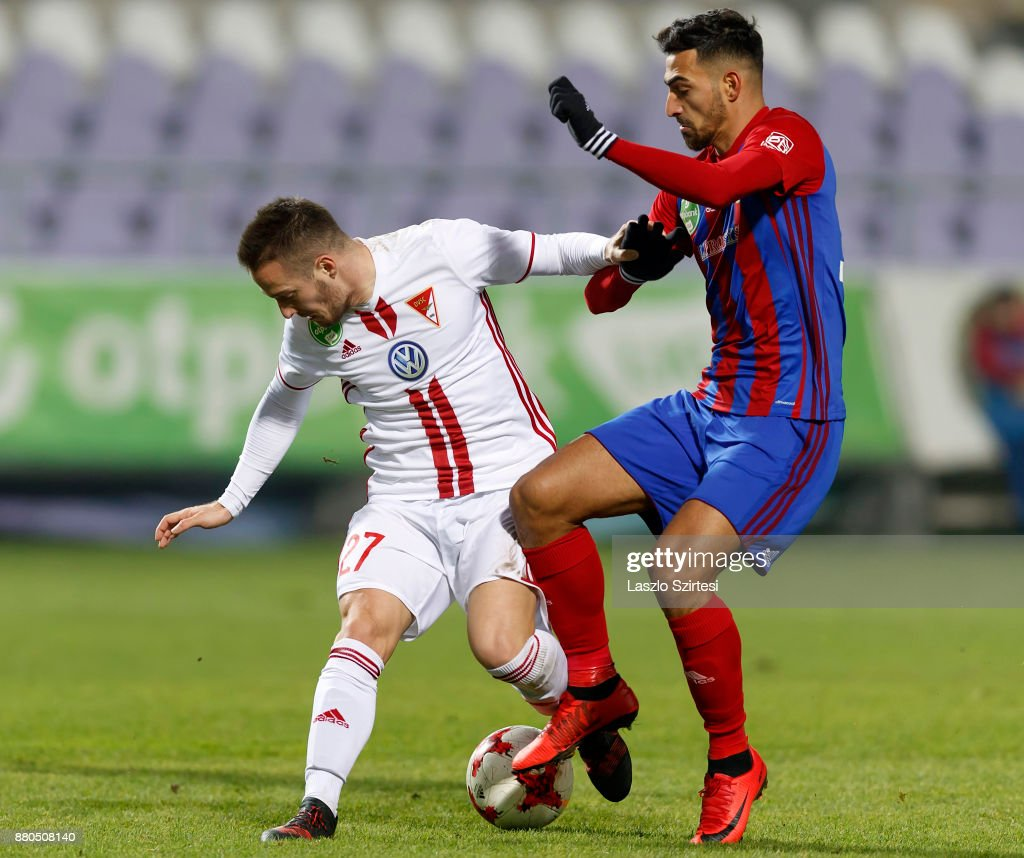 Nikolaos Vergos (R) of Vasas FC competes for the ball with Adam Bodi #27 of DVSC during the Hungarian OTP Bank Liga match between Vasas FC and DVSC at Ferenc Szusza Stadium on November 25, 2017 in Budapest, Hungary.
