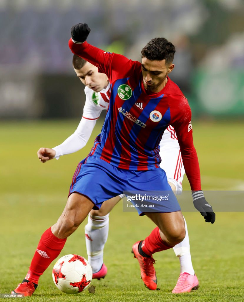 Nikolaos Vergos (R) of Vasas FC covers the ball from Janos Ferenczi (L) of DVSC during the Hungarian OTP Bank Liga match between Vasas FC and DVSC at Ferenc Szusza Stadium on November 25, 2017 in Budapest, Hungary.