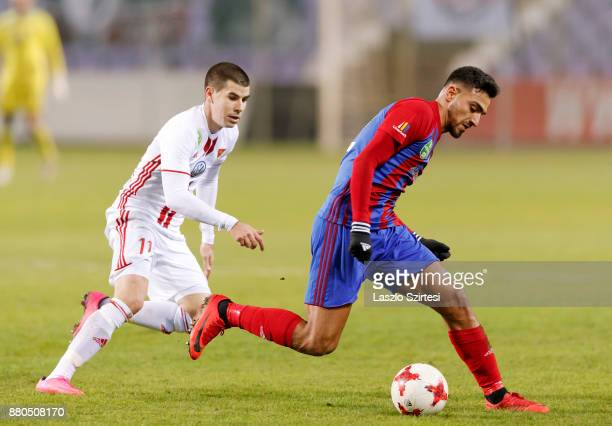 Nikolaos Vergos of Vasas FC wins the ball from Janos Ferenczi of DVSC during the Hungarian OTP Bank Liga match between Vasas FC and DVSC at Ferenc...