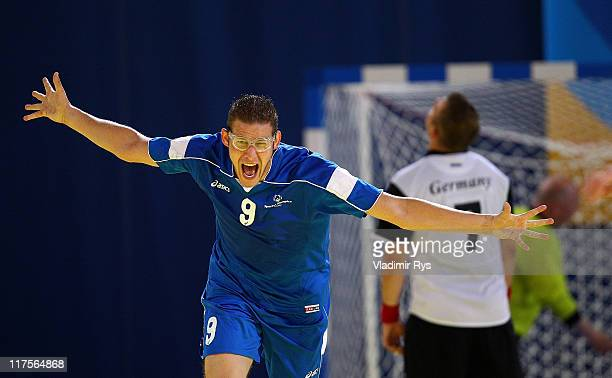 Nikolaos Vessalas of Greece celebrates after scoring a goal during the handball match between Germany and Greece at the Athens 2011 Special Olympics...