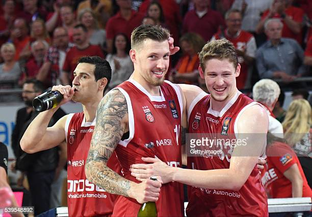 Nikolaos Zisis Bradley Wanamaker and Patrick Heckmann celebrate after winning the German basketball championship after game three of the 2016 BBL...