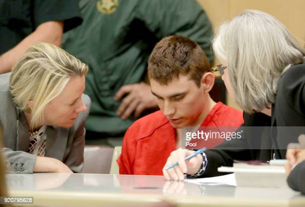 Nikolas Cruz appears in court with attorney Melissa McNeil for a status hearing before Broward Circuit Judge Elizabeth Scherer on February 19 2018 in...