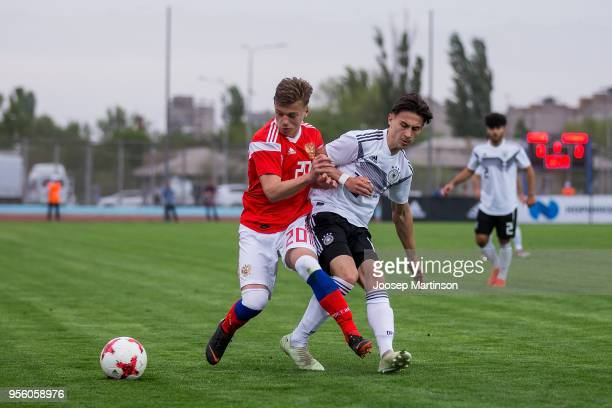 Nikolas Kuhn of Germany competes with Ivan Tarasov of Russia during the U18 international friendly match between Russia and Germany at Zenith Stadium...