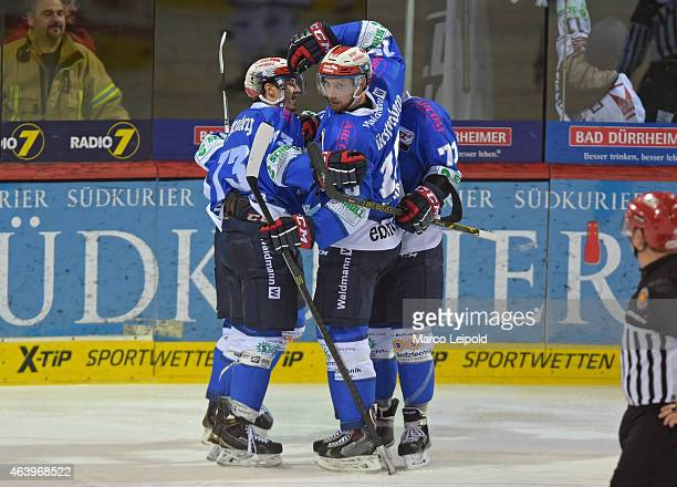 Nikolas Linsenmaier, Stephan Wilhelmq and Jonah Hynes of the Schwenninger Wild Wings celebrate after scoring the 1:3 during the game between...