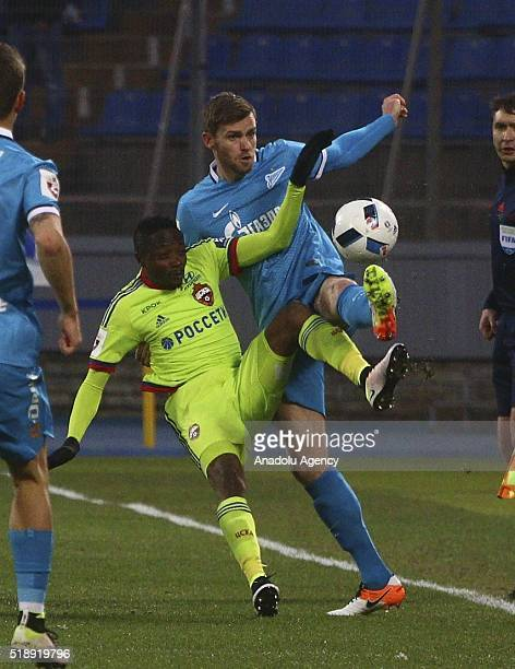 Nikolas Lombaerts of Zenit Saint Petersburg in action against Ahmed Moussa of CSKA Moscow during the Russian Premier League football match between...