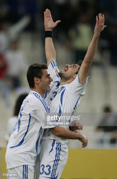 Nikolas Lymperopoulos of Greece is congratulated by Konstantinos Katsouranis after he scores their third goal during the Euro 2008 Group C Qualifying...
