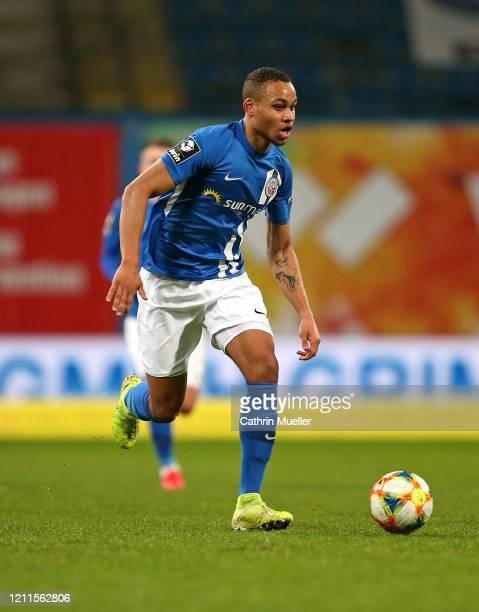 Nikolas Nartey of Hansa Rostock runs with the ball during the 3 Liga match between Hansa Rostock and Eintracht Braunschweig at Ostseestadion on March...