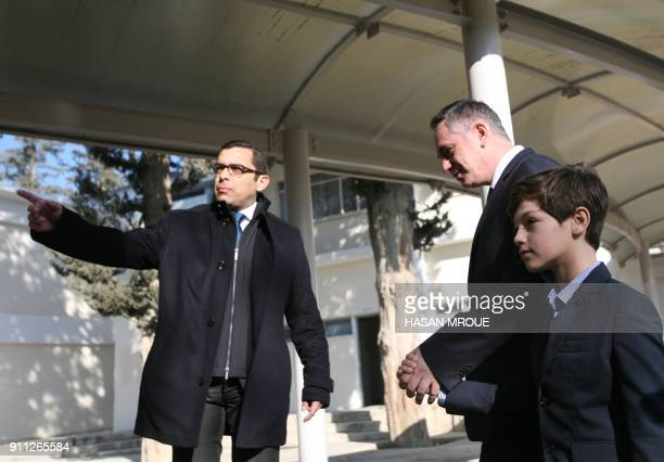 Nikolas Papadopoulos a former president's son and candidate in the 2018 Cypriot presidential election arrives with his son Tassos Papadopoulos at a...