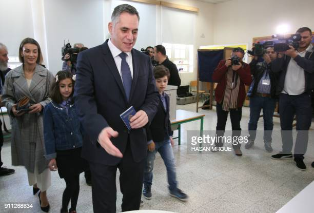 Nikolas Papadopoulos a former president's son and candidate in the 2018 Cypriot presidential election arrives with his family to cast his vote at a...